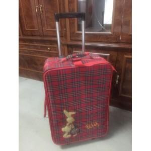 Gurulós utazó bőrönd